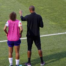 coach on soccer field with athlete