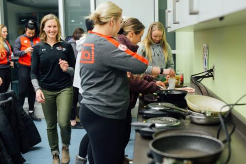 group of girls cooking in the CSCA kitchen