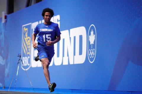 man running in front of RBC Training Ground sign